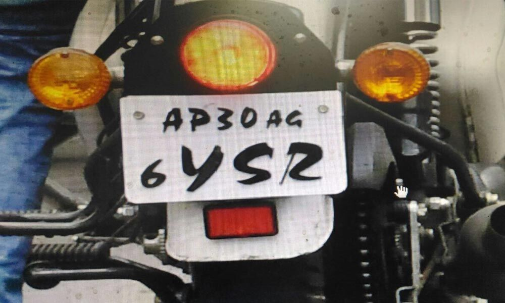 A motorist riding a two-wheeler that has an altered registration number plate